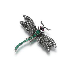 Diamond, emerald and ruby brooch, circa 1900 - Modeled as a dragonfly, the pierced wings set with rose diamonds, to a cushion-shaped emerald tail and circular-cut ruby eyes, French assay and maker's mark.