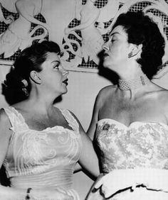 Judy Garland looking up to Rosalind Russell.