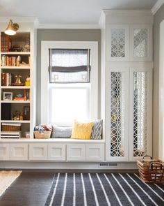 window seat, shelving for books, and coat closet all built in
