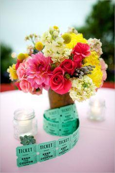 brightly colored florals and carnival ticket centerpiece #weddingreception #weddingdecor #weddingchicks http://www.weddingchicks.com/2014/02/04/country-fair-wedding/