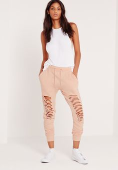 Nail that off duty look and get set for major chilled out vibes. Grunge out your style with its nude hue, jogger style and distressed knee detail; you'll be toughening up your day look. Team with a jersey basic crop top, flatforms and bag a...