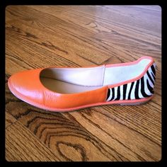 Diane Von Furstenberg Flats Orange leather and zebra stripe (calf hair) Diane von Furstenberg flats. Worn once. Like new. Pairs well with the orange Marc Jacobs bag. Diane von Furstenberg Shoes Flats & Loafers