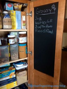 chalkboard paper on the back of the pantry door for writing grocery lists