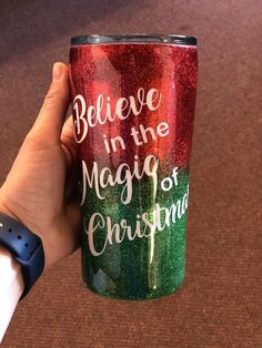 """This 20 oz tumbler is decorated with a red and green glitter ombré. It has a white decal that says """"believe in the magic of Christmas"""" and has plenty of room for personalization! Want it personalized? Leave a note at checkout or email mtdesignsboutique@gmail.com with order number and personalization. (Note this will add 1-2 weeks to turnaround time due to the need for the epoxy to completely cure before shipping) This is an insulated double walled stainless steel tumbler that will keep drinks co Christmas Tumblers, Christmas Cup, Christmas Stuff, Christmas Crafts, Glitter Wine, Glitter Cups, Green Glitter, Diy Tumblers, Custom Tumblers"""