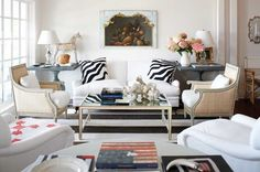 Love the chairs and the black and white zebra pillows