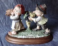 Vintage G Armani Capodimonte Gullivers World Boy & Girl Carrying Grapes Figurine