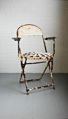 Three favorites here.  Rust, old paint, and vintage garden furniture.