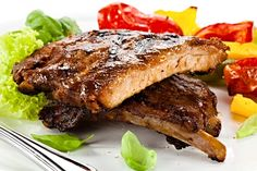 Clients can enjoy authentic Southern-style cuisine with mouthwatering BBQ ribs, pull pork, and brisket included in the menu Roast Pork Chops, Baked Pork Chops, Lamb Chops, Grill Restaurant, Ribs On Grill, Bbq Ribs, Barbecued Lamb, Lowes Food, Smokehouse Bbq