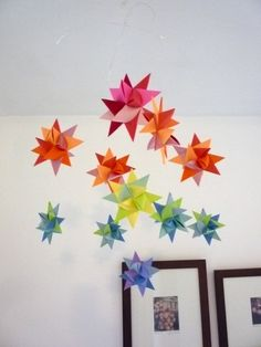 Hand folded paper star mobile made by the Starcraft on Etsy