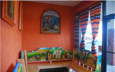 The brightly colored and well drawn artwork in this waiting area helps turn the customer's wait time into an art experience