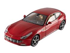 Ferrari FF Diecast Model Car by Mattel X5490 This Ferrari FF Diecast Model Car is Red and features working steering, suspension, wheels and also opening bonnet, boot with engine, doors. It is made by Mattel and is 1:18 scale (approx. 24cm / 9.4in long).    The FF - an acronym for Ferrari Four (four seats and four-wheel drive) - is designed by Pininfarina and ushers in an entirely new GT sports car concept.