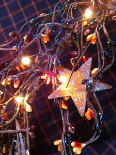 Hey, I found this really awesome Etsy listing at http://www.etsy.com/listing/158742733/pipberry-garland-rusty-stars-with-teeny lights in various choices