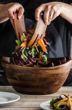 Pin for Later: 10 Pretty Kitchen Gifts For Moms Who Cook Acacia Salad Bowl and Servers Acacia wood is burnished into a graceful shape in this bowl and servers set ($110).