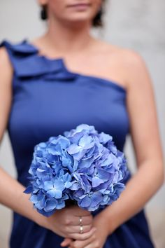 Blue bridesmaid bouquet - hydrangea - Bridesmaids will be wearing black with sashes that match their flower color.