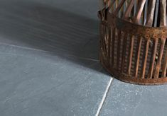 Colours range from dark to light grey with a lightly riven and tumbled surface and tumbled edge.