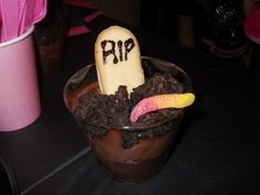Self Serve Graveyard Bar? Pudding and crushed oreos as dirt. Gummy worms, candy corn pumpkins, whipped cream ghosts, milano cookie gravestones...