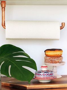 When Tan of Squirrelly Minds gave her kitchen a mini makeover, copper pipe played a big part in the new design. The orange-hue metal can be both edgy and inviting, and her clever suspended DIY paper-towel holder uses the shiny material in an unexpected way.