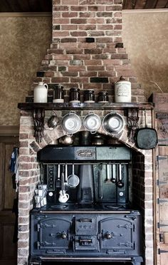 """magicalhomestead:  """" If you're going to have a vintage stove, you need to put a brick chimney around it.  thecountryphiles.com  """" Rustic Kitchen, Mini Kitchen, Old Kitchen, Kitchen Stove, Vintage Kitchen, Kitchen Decor, Stove Fireplace, Fireplace Design, Fireplace Ideas"""