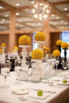 yellow bouquets atop of white pedestals.