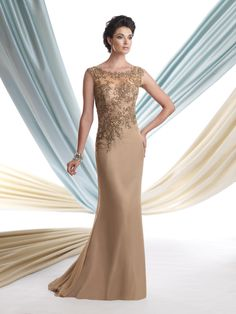 Two-tone chiffon slim A-line gown with scalloped illusion bateau neckline, bodice features hand-beaded embroidered floral design and asymmetrically dropped waistline, sweep train. Matching shawl included. Sizes: 4 – 20, 16W – 26W