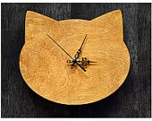 Cat head shape wall clock in natural pine colour- with hours marked with dots. €17,00, via Etsy.