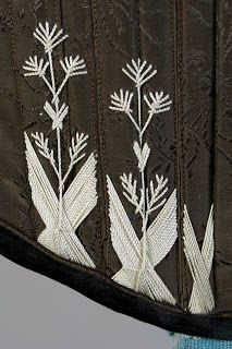 M Grochovska, Poland, 1880s. The exterior is black brocade and the interior is pale blue moire. Detail of flossing.