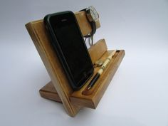 ORIGINAL STYLE!!!  This All-Phone Docking station provides a place to charge your phone, with space for keys, watch, glasses, pen - all those things you used to have to hunt for. This hand crafted, modern accessory is a convenient place to keep all your everyday items with style. It can be used as a stand for charging your phone, with no need to unplug the phoneWhile your phone is charging, the cable keeps your phone stable enough for your phones touch screen to be fully functional without…