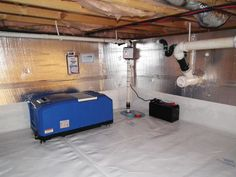 A dehumidifier and crawl space sump pump installed with our vapor barrier