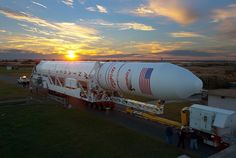 USA - 25.10.2014 An Antares rocket rides a self-propelled mobile transporter Friday to launch pad 0A at Wallops Island, Va. The Orbital Sciences Corp. Antares rocket and Cygnus cargo freighter are set for launch at 6:45 p.m. EDT (2245 GMT) from the Mid-Atlantic Regional Spaceport at NASA's Wallops Flight Facility in Virginia. - Credit: Orbital Sciences Corp.