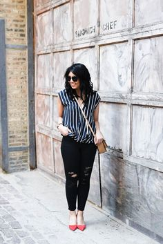 Pop of red- Wearing kitty heels with black distressed denim and draped vertical stripe blouse.