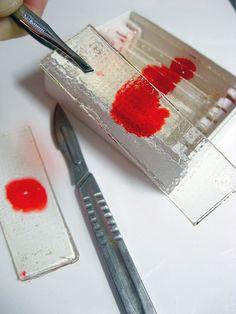 Dexter blood slide lollipops / suckers. Great idea for halloween snacks!