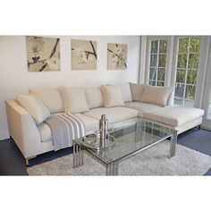 This Divina sectional offers a modern minimalist look and maximum surface area. Clean lines, wide seating and soft cushioning make for a great, modern sectional for any room. Easy to clean fabric ensures this sectional will work for any living space.