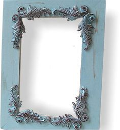 A bit of paint and flourishes made of molded polymer clay turn this dull picture frame into a beautiful piece. Video tutorial. #smalls
