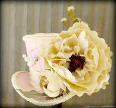 Antique Pinks and Creams Flower Explosion Alice in Wonderland Mini Top Hat, Tea party hat, Mad Hatter Hat, Bridal Shower, Baby Shower. $45.00, via Etsy.