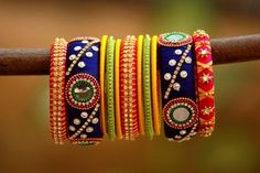 Multicolored Ethnic Decorated Single Hand Silk Threaded Bangle Set With Mirror Work (Size Rs. 839 Our price is inclusive of GST taxes Silk Thread Bangle Set Multicolred Set Pearls, Stones And Mirrors Embellished Size- Silk Thread Bangles Design, Silk Thread Necklace, Silk Bangles, Thread Jewellery, Kundan Bangles, Diy Jewellery, Pearl Necklace Designs, Bangles Making, Bangle Set