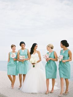 Bridesmaids in Aqua -- pretty wedding color. See more of the wedding on #smp here: http://www.StyleMePretty.com/midwest-weddings/2014/04/10/nature-museum-wedding-in-chicago-by-yazy-jo/ Photography: YazyJo.com