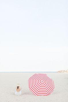 striped umbrella | Image via Style Me Pretty