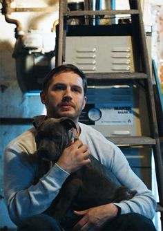 Tom Hardy as Bob Saginowski & Rocco - The Drop - Tom Hardy The Drop, Tom Hardy Dog, Tom Hardy Actor, Hard Boy, Tom Hardy Photos, Man And Dog, Partying Hard, Super Party, Welcome To The Family
