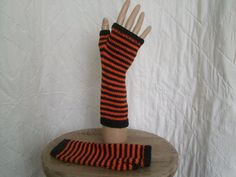 Women's accessories.Goth Halloween hand knitted fingerless mittens. Stay warm on your trick or treating - one of a kind design hand made in Wales available from www.liliwenfachknits.co.uk