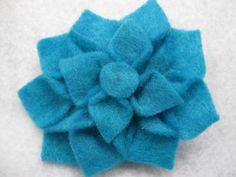 Cute little teal dahlia hair flower. Small size makes it great for younger girls and babies. $3 on my Zibbet Shop!