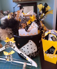 Cheer Camp Goodies all packaged in their buckets. OK, I'll admit, I freaked out just a little bit. I want this experience for the girls to be special and it was fun!!  #cheercamp #cheerswag