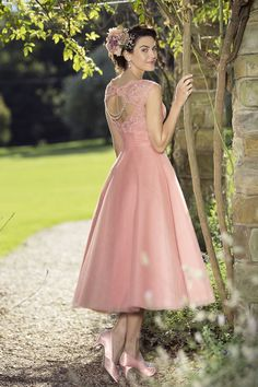 The True Bridesmaids collection is full of gorgeous, fashionable gowns that are available in an extensive range of colours. Pink mid length bridesmaid dress - click to read more!