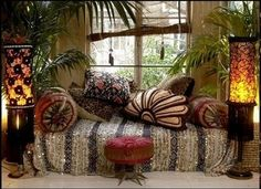 moroccan wedding blanket with sparkles and pillows and plants and light!