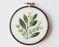 Vancouver-based artist Caitlin Benson (of Cinder & Honey) embroiders vintage-inspired flowers that will last a lifetime. Before reaching for her embroidery hoop, the designer always starts with a sketch on paper, which undergoes several revisions before Benson begins preparing her needle and thread. Once this initial stage is complete, the creative breathes life into her …