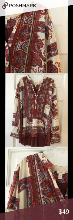 """Anthro Tiny hi lo tunic blouse Rayon with polyester/spandex contrast. Hand wash.  Underarm across 21"""". Length 25-31"""".  Excellent condition. EUC. Anthropologie Tops Blouses"""