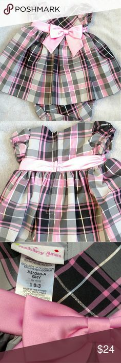 Ashley Ann Satin Party Dress #NWT Present your angel to the world in this pink and gray satin special occasion dress. Pretty in #plaid. Stunning pink and gray with metallic silver threads. Bubblegum pink bow on sash. Back zipper and matching plaid bloomers. Retail $44.00. Price is Firm. Already discounted to provide only small profit to pay for free legal help to women and children. ❎No offers❎ Ashley Ann Dresses