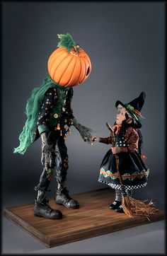 "Jodi and Richard Creager, Creager Studio - Masie the little witch and Mr. Jack ""O"" Lantern. not in 1:12 scale - Masie stands 8 3/4"" and Jack is 13"" tall. Their artistry is so amazing I decided to pin it here anyway. Sold oo ebay for $680."