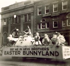 Hess Brothers Easter Bunny parade float, late 1950s. Allentown, PA. showing the old Allentown Public Library in the background.