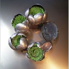 From his studio in Yokohama, Japan, Shinji Nakaba  works with a variety of materials, treating each with equal measure regardless of its value. This great brooch is crafted from silver and plastic bottles, a semi precious stone and a cameo. You can find his work on Etsy under his own name. #handmade #design #silver #plastic  #brooch #pin #recycle #clever #jewelry #jewellery #instajewelry #contemporaryjewelry #shinjinakaba