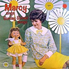 sunday school songs: this cover has a bad hairdon't and a creepy doll. only 2 if the necessary elements for a true Scary Christian Album Cover. (other elements can be matching polyester outfits, an accordion and a ventriloquist dummy) BUT it's got nuclear reactor sized fake flowers, also acceptable